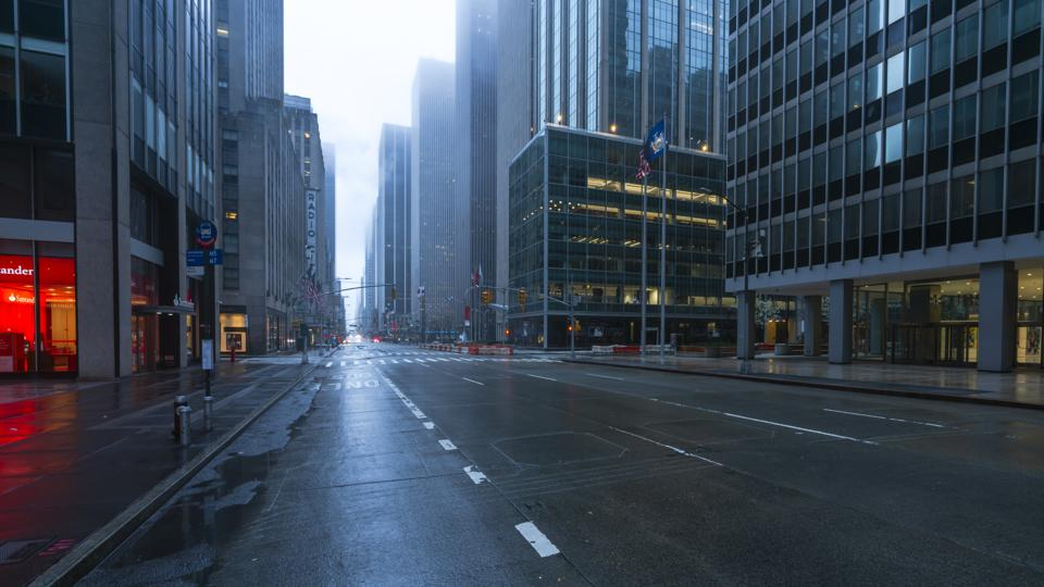 COVID-19 Effect to New York City. People and traffic disappeared from Midtown Manhattan 6th Avenue for impact of COVID-19 in the rainy morning New York City NY USA on Mar. 29 2020.