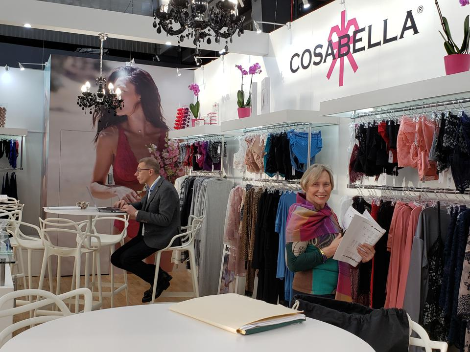 Campello stands amongst clohtes in a Cosabella retail store.