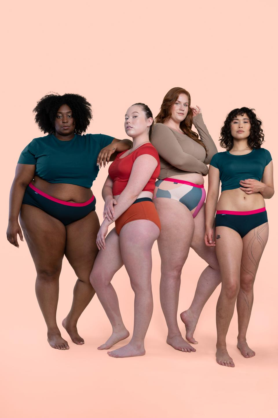 Four women looking at camera in tops and underwear