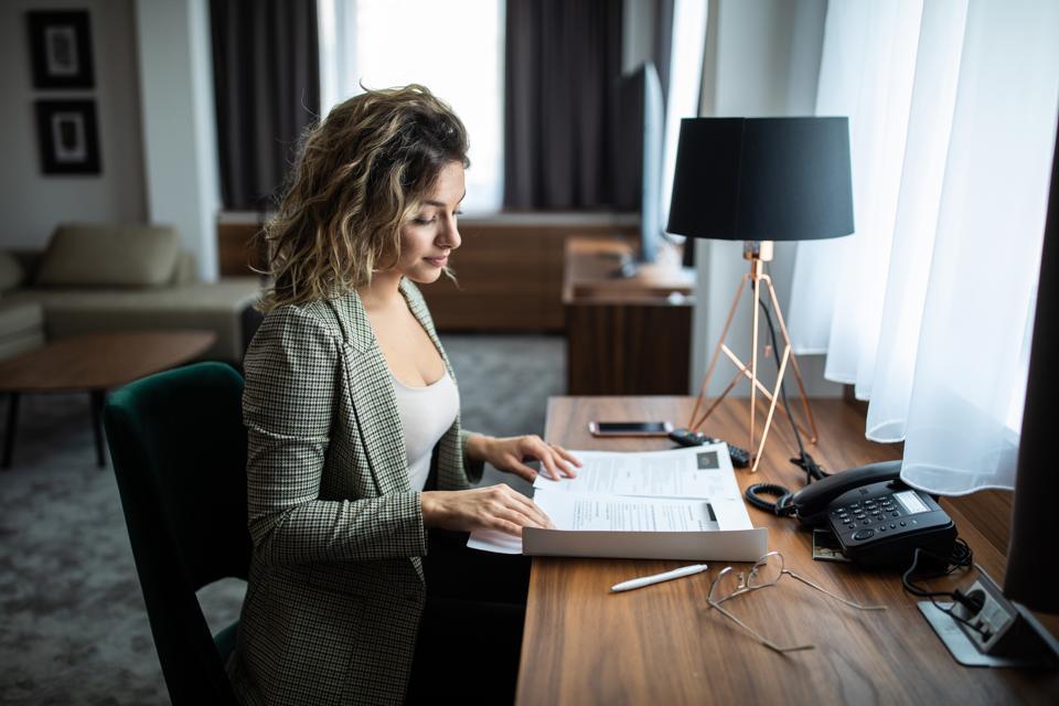 Businesswoman at hotel suite