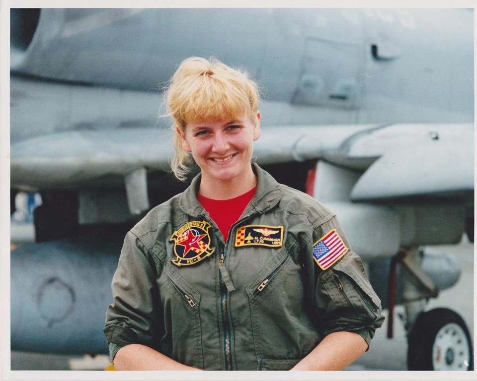 Missy Cummings in front of a fighter jet.