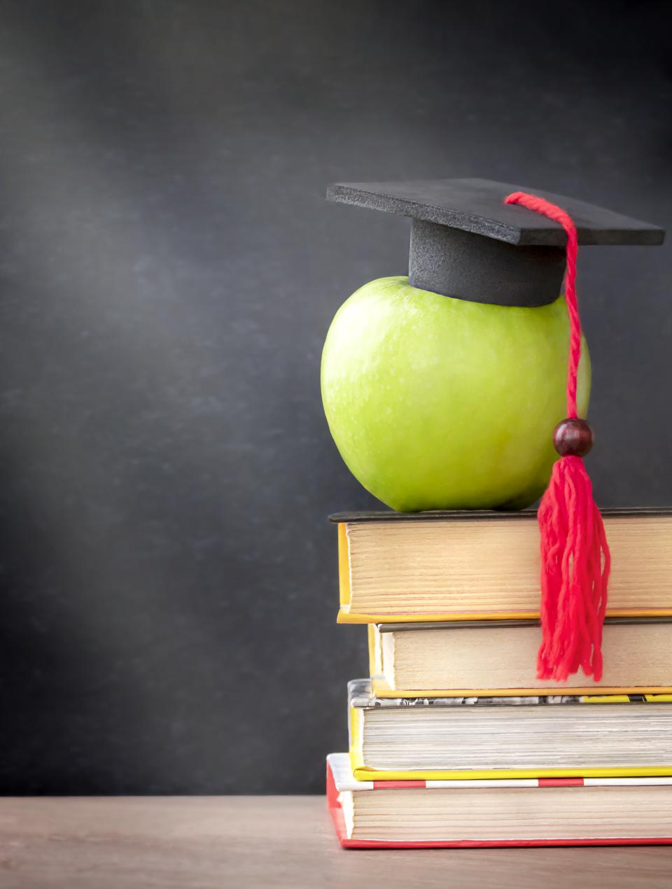 green apple with mortar board
