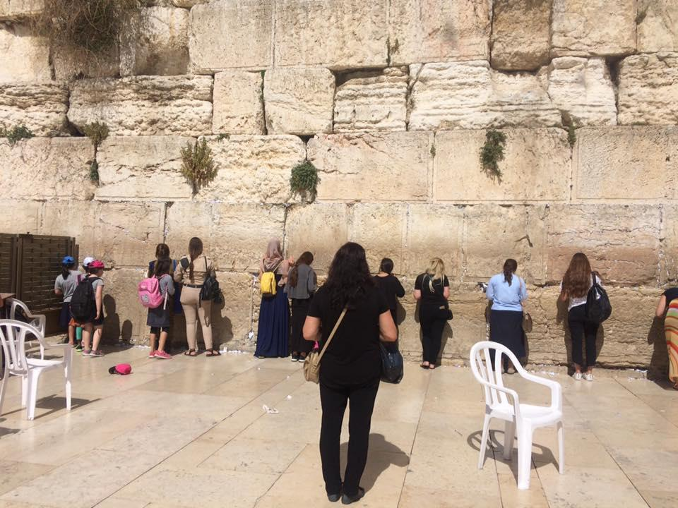 The Western Wall in Jerusalem also attracts visitors of different faiths.