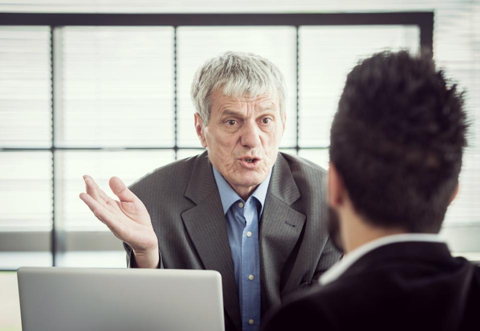 Senior CEO having hard talk with employee
