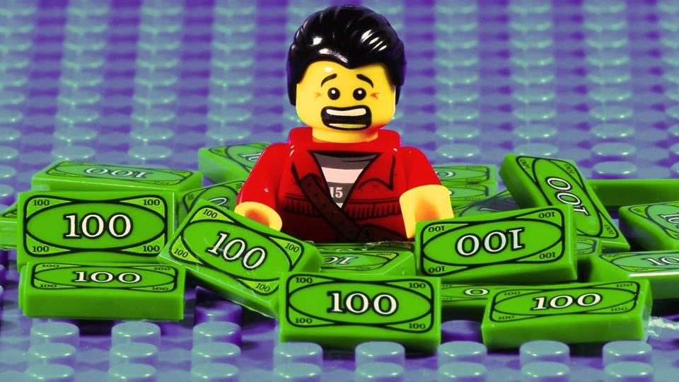Lego man swimming in money realizes he got what he paid for
