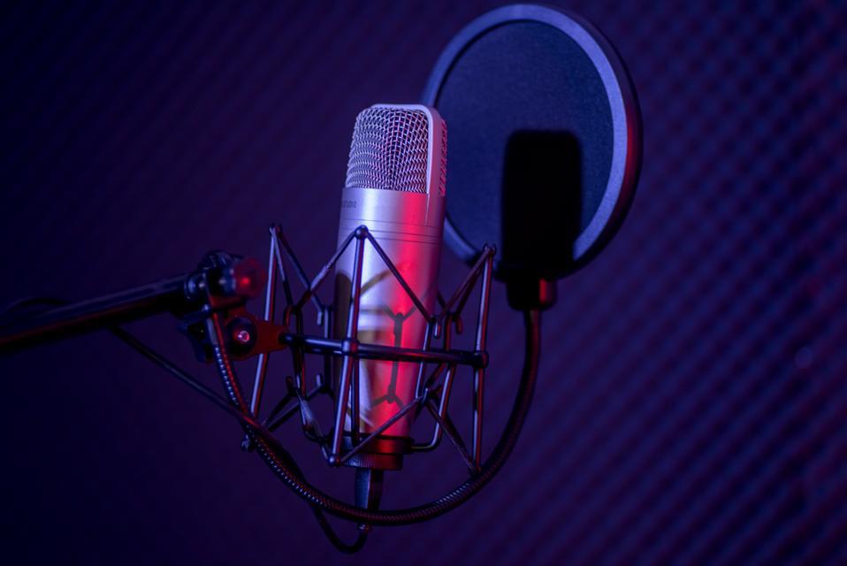Microphone in radio station broadcasting studio.