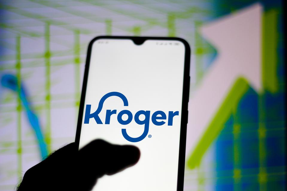 In this photo illustration the Kroger Company logo seen...