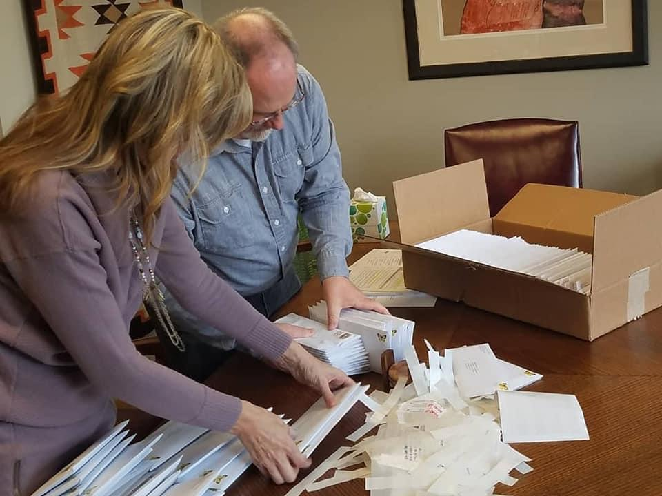 Stenquist and Parker stuff envelopes with letters to local attorneys and prosecutors.