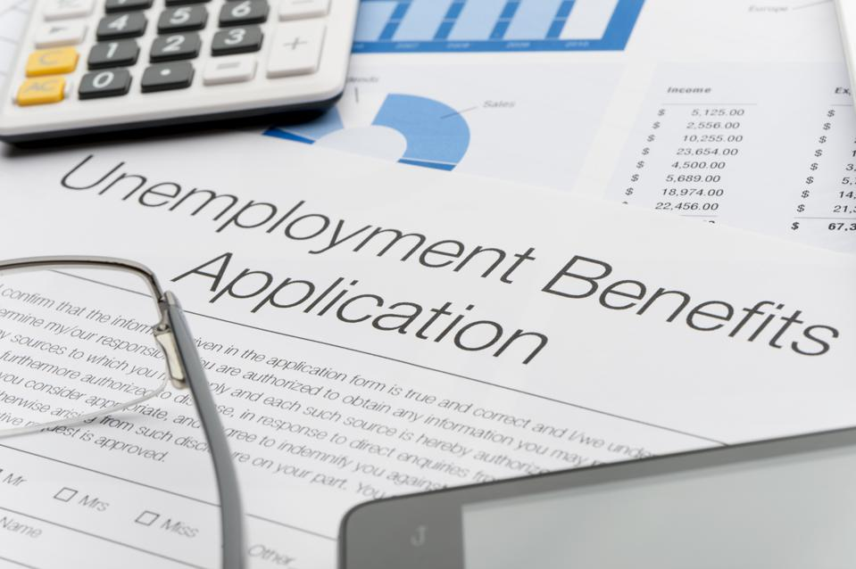 Unemployment benefits application form with paperwork
