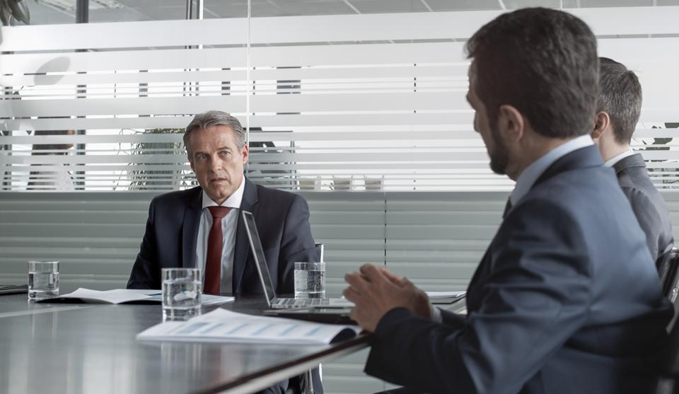 CEO of company talking in meeting