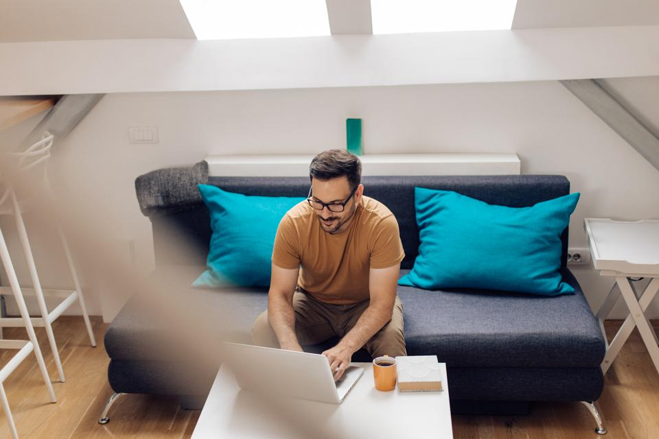 Man working online from his living room