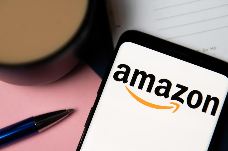 In this photo illustration Amazon logo displayed on a...