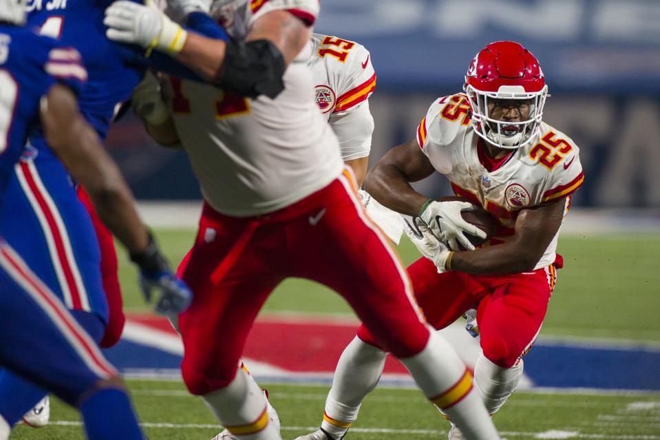 Clyde Edwards-Helaire runs behind reshuffled Chiefs offensive line.