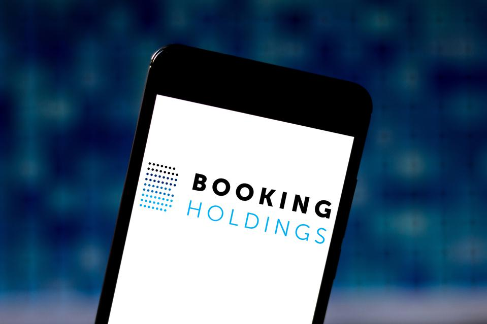 In this photo illustration the Booking Holdings logo is seen...