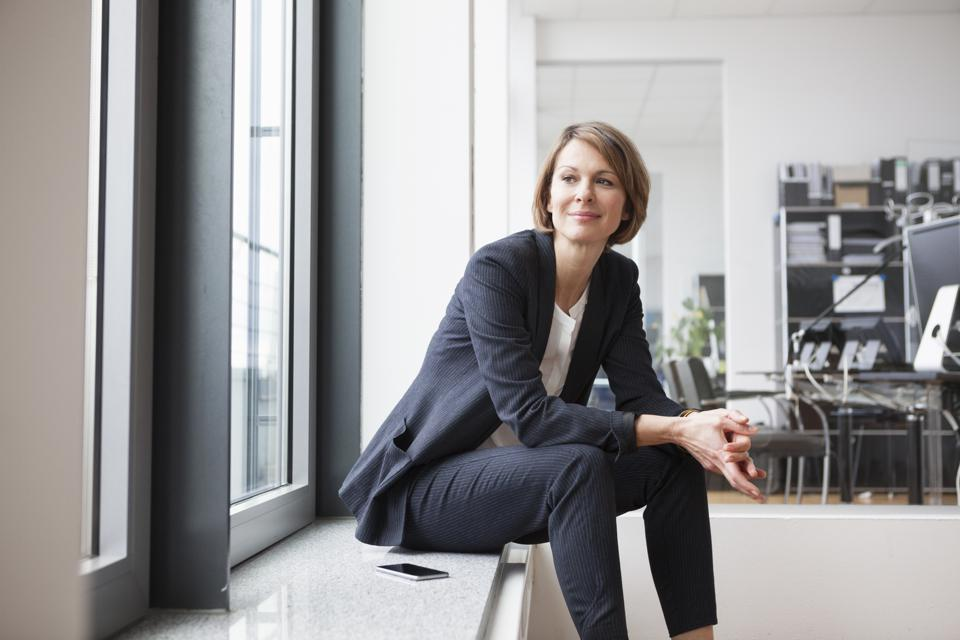 Businesswoman sitting at the window