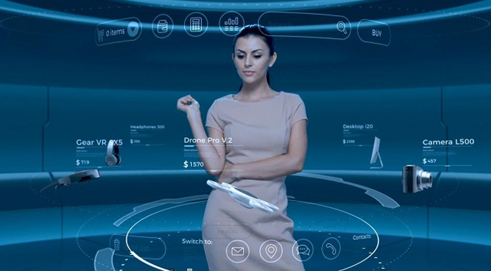 A woman standing in front of a fully immersive touch screen shopping display.