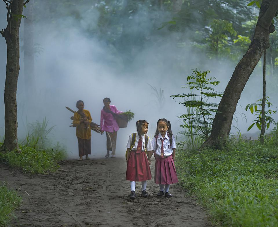 The World We Want, global photo contest: little girls walking in the woods in Indonesia
