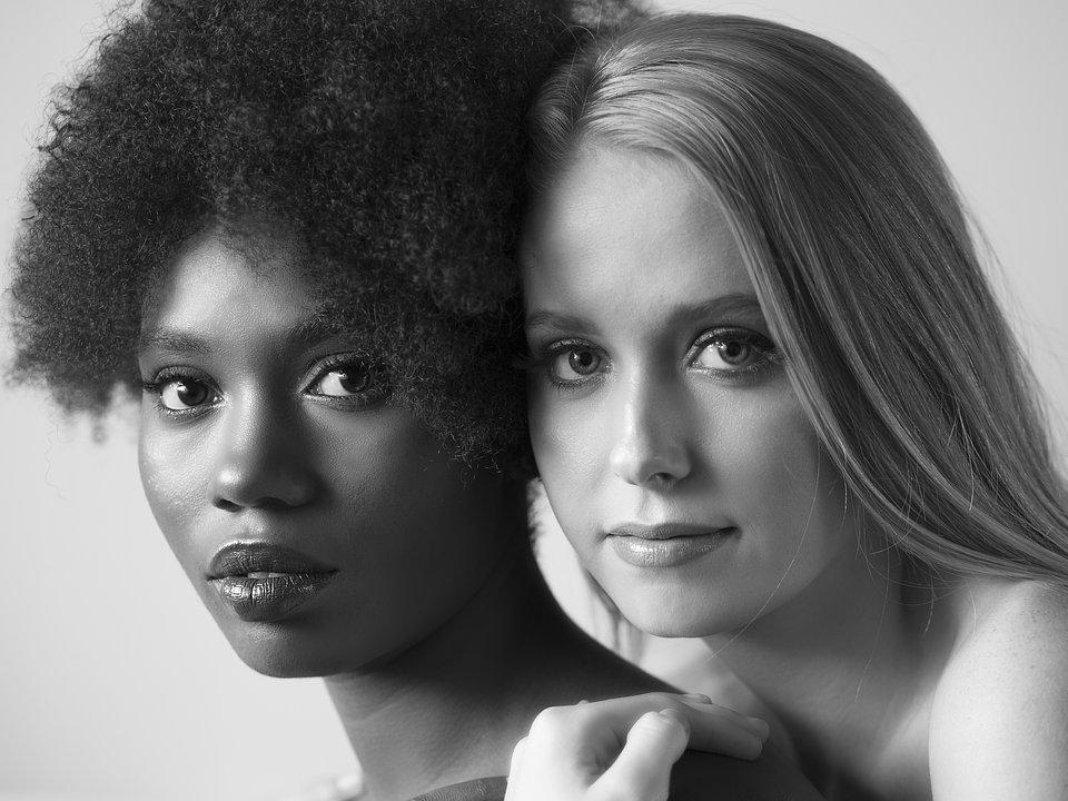 The World We Want, global photo contest: faces of a white and a black beautiful women.