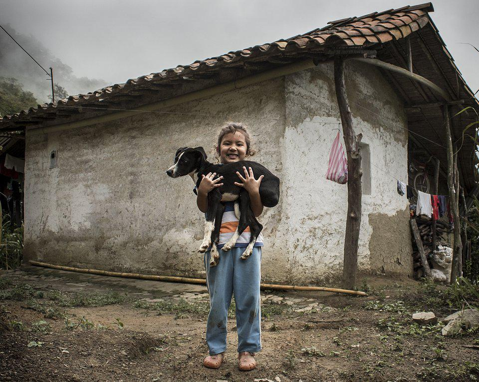 The World We Want, global photo contest, little girl carrying a dog in her arms.