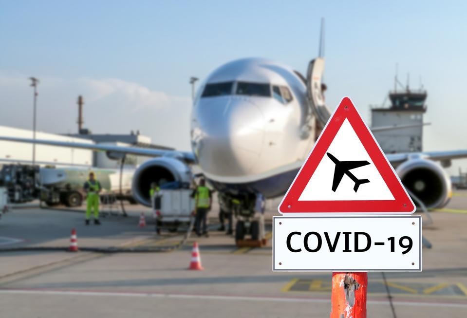 Airplane at the airport warning sign coronavirus