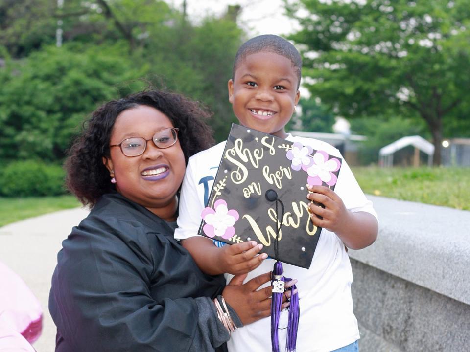 Generation Hope Scholar Alumna Tanazia at her graduation from Trinity Washington University with her son.