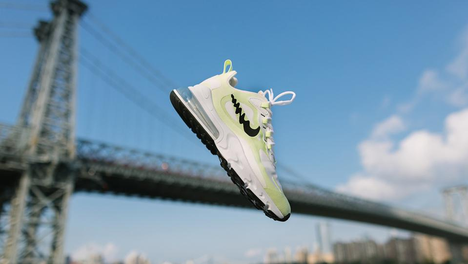 Nike sneaker flies in the air with bridge in the background