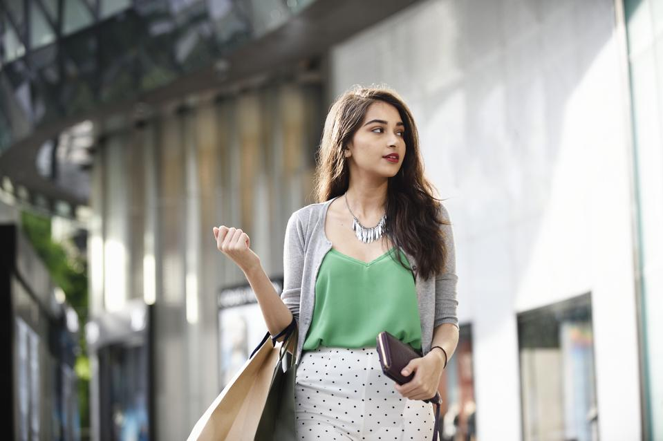 Portrait of a wealthy Indian woman outside a luxury mall