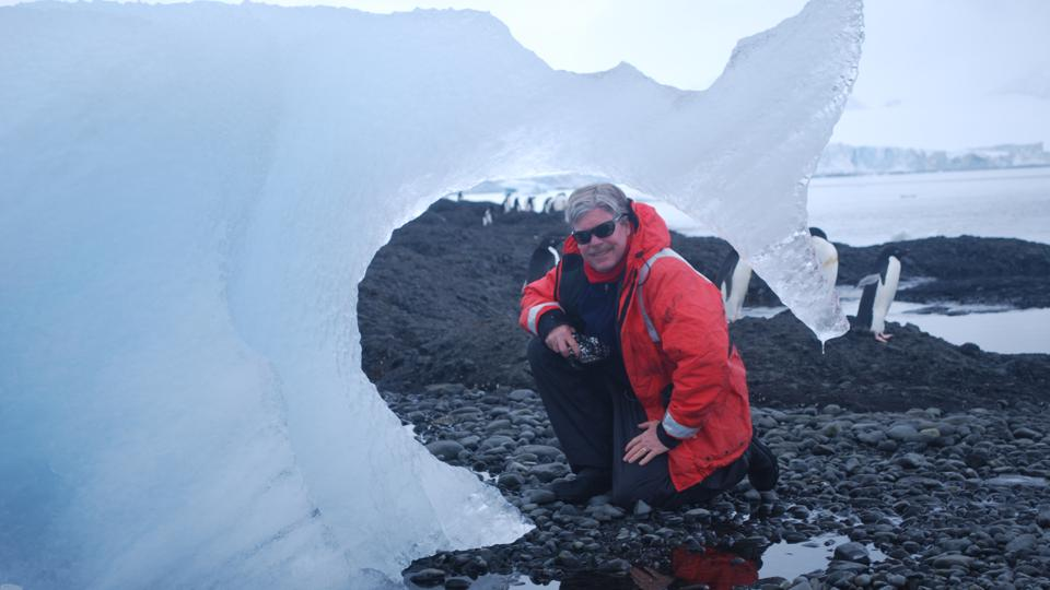 Dr. James McClintock in Antarctica with penguins