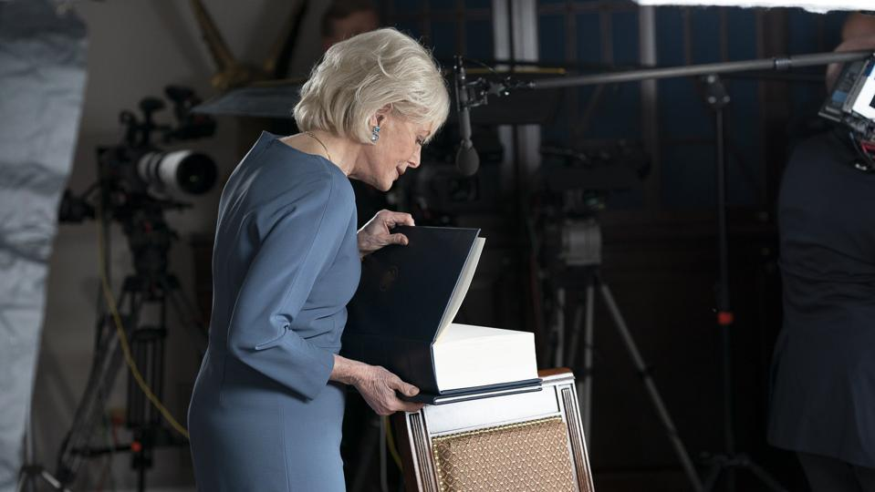 60 Minutes correspondent Lesley Stahl opens a book provided by the White House while preparing to tape an interview with President Donald Trump on Tuesday, Oct. 20, 2020.