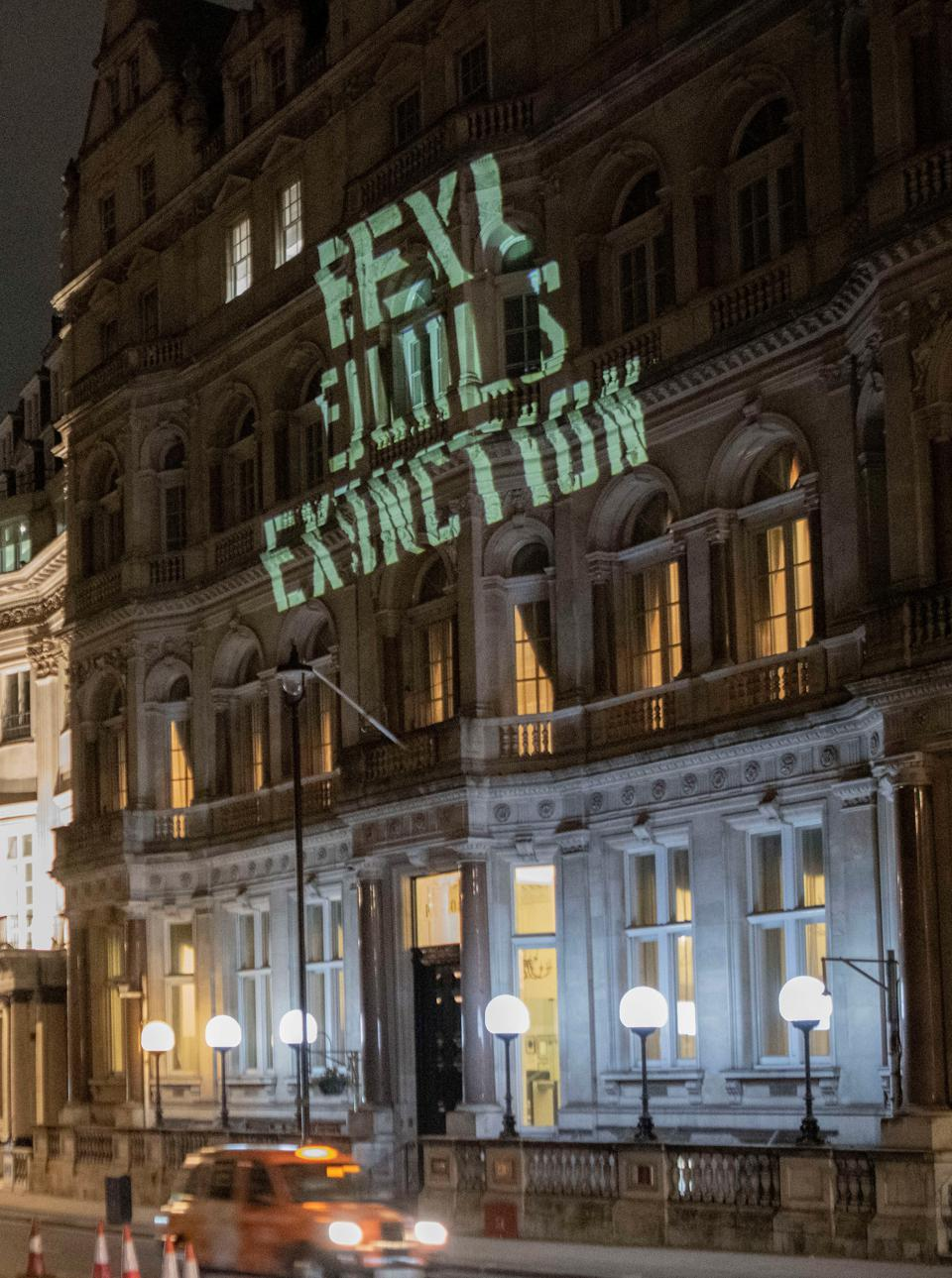 19 Oct: Sign saying ″EEXI = Extinction″ is projected against the Japanese Embassy by protestors on Monday