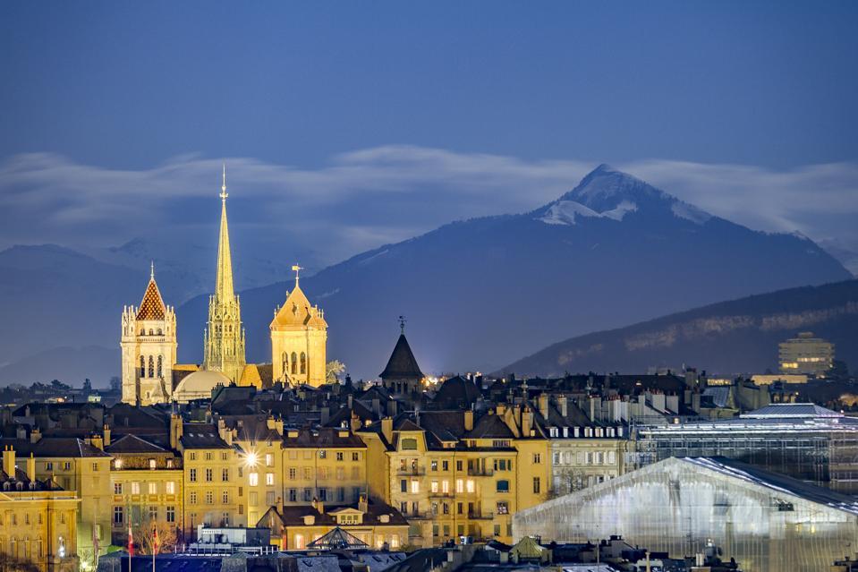 Downtown Geneva, beneath snowy mountains