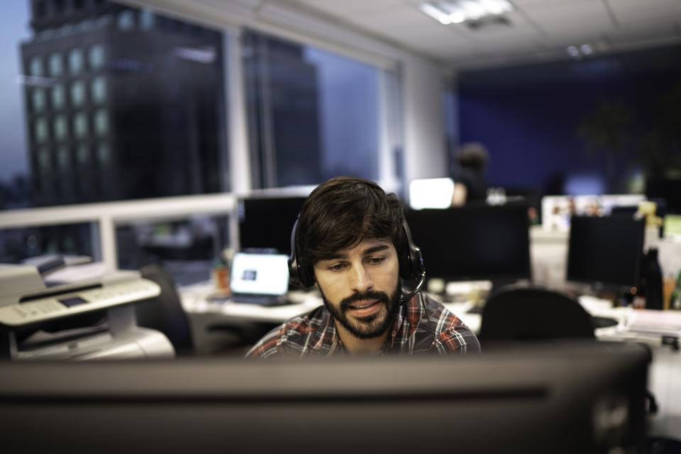 Employee working with headset in office callcenter