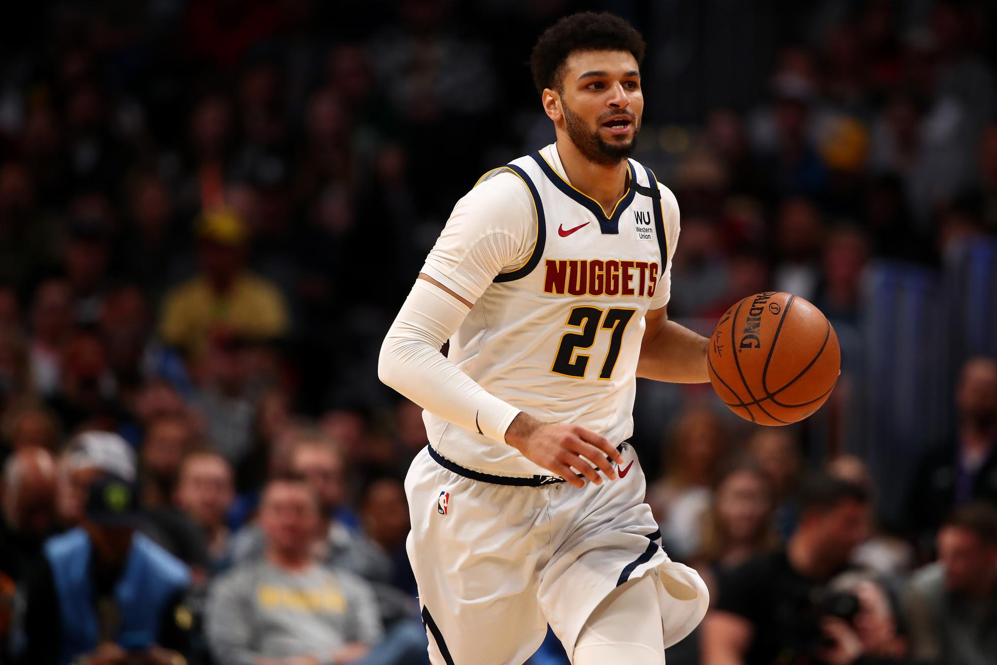 Denver Nuggets guard Jamal Murray dribbles up the court at the Pepsi Center during a 2020 NBA game.