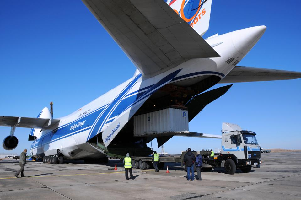 Shipment being unloaded from an air cargo plane
