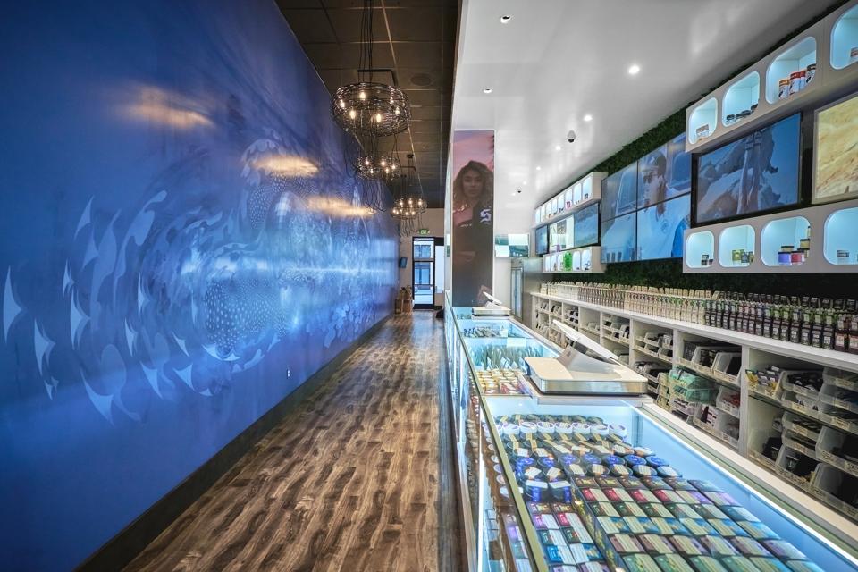 glass counter tops, wood floors, modern retail shop