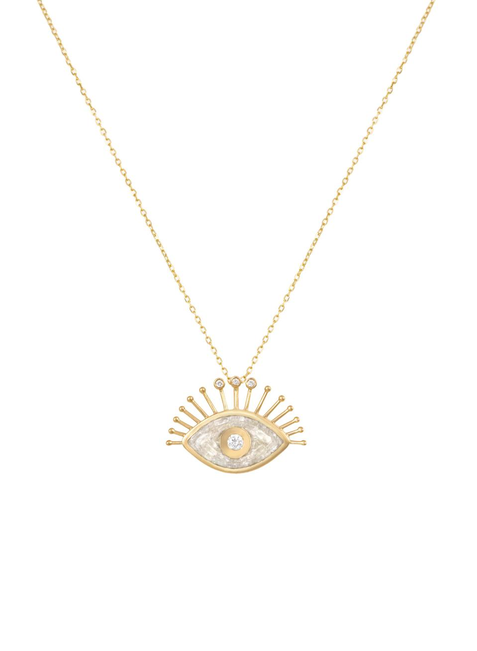 An 18K gold and diamond eye pendant necklace by Dima and Tanya Nawbar of L'atelier Nawbar