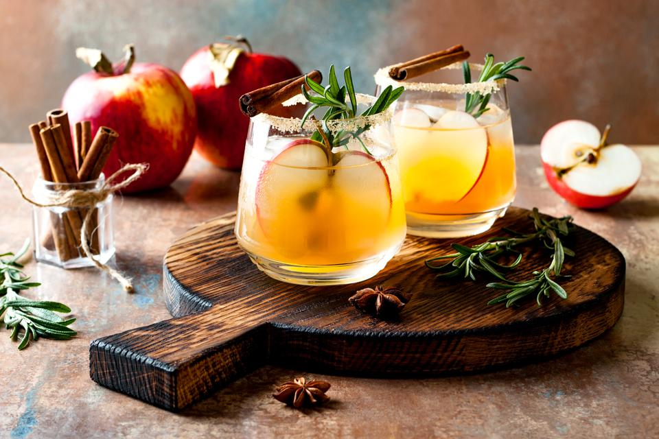 Fall mocktail with apple, cinnamon, rosemary and star anise.