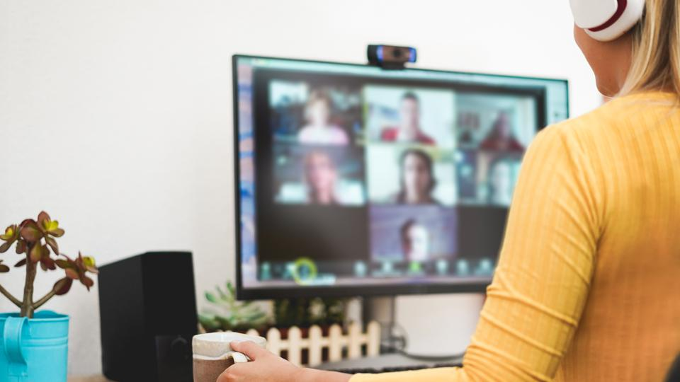 Young woman having a discussion meeting in video call with her team - Girl having chatting with friends on computer web app - Technology and smart work concept - Focus on hand