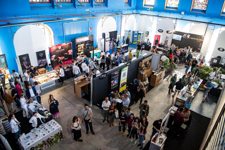 People visit presentation stands and tasting booths at a chefs' congress in Portugal