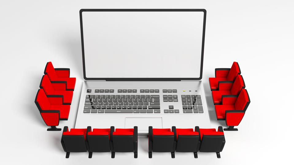 Cinema chairs around a laptop, blank white screen for copyspace, white background. 3d illustration