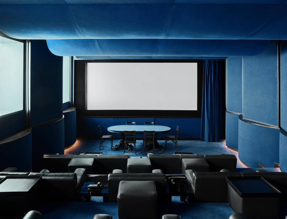 The subterranean theater awash in blue velvet.