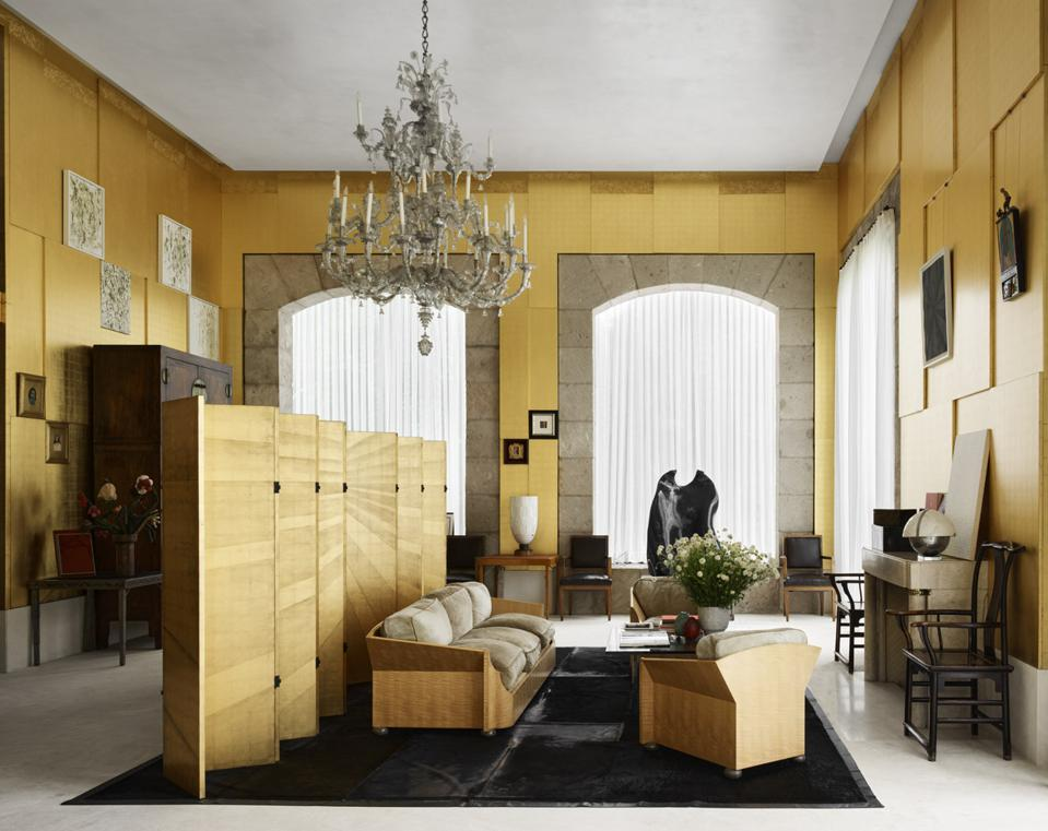 A living area, featuring gold accents and a gilded Chinese painted screen.