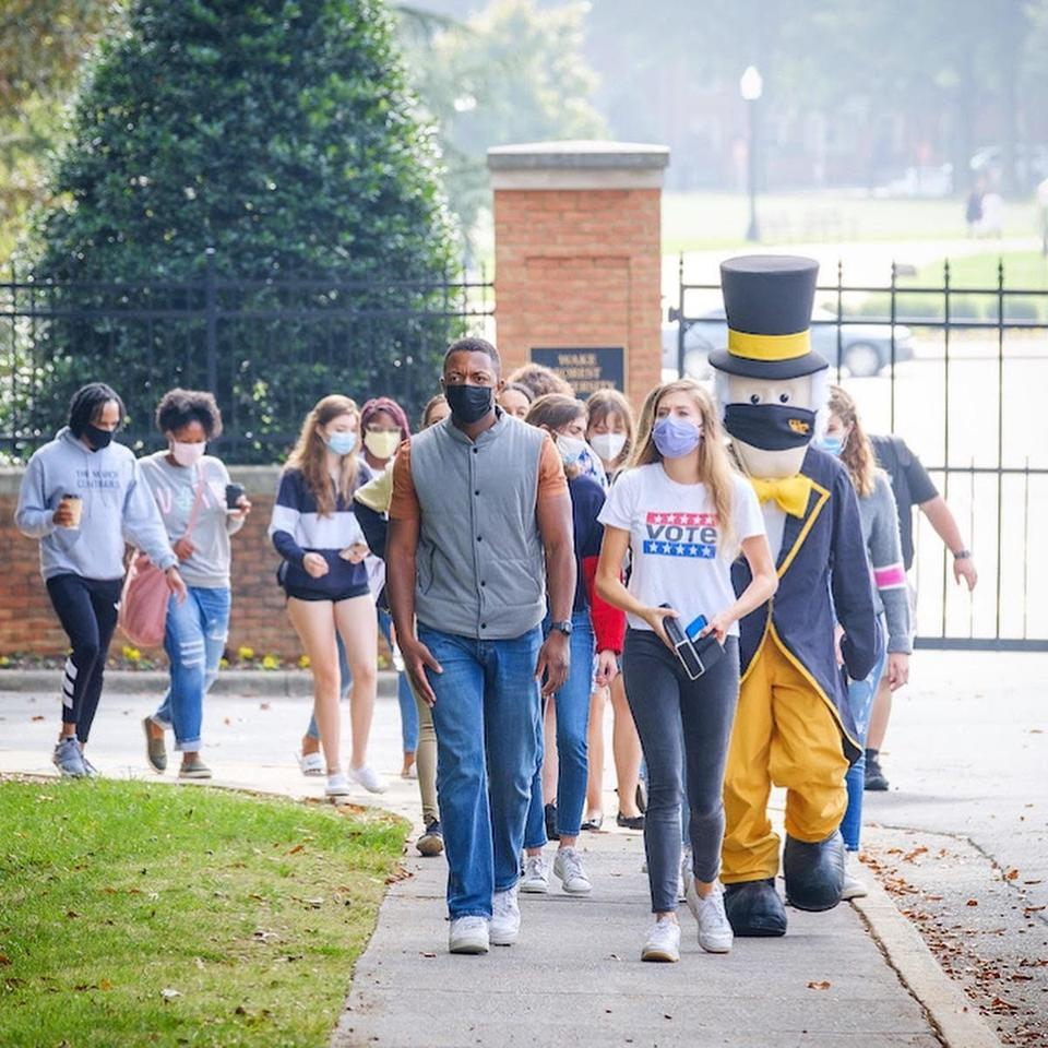 Wake Forest students march to the polls for early voting.