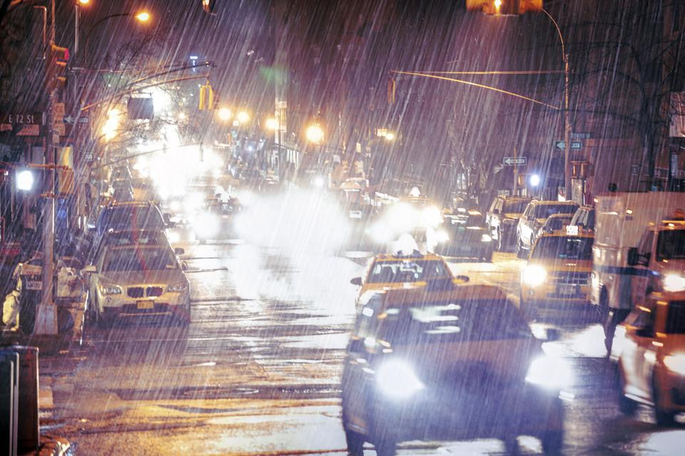 Cars at night during heavy rain. Lexington Avenue, Manhattan, New York, US