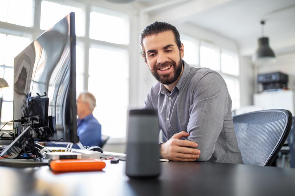 Businessman using digital speaker at office