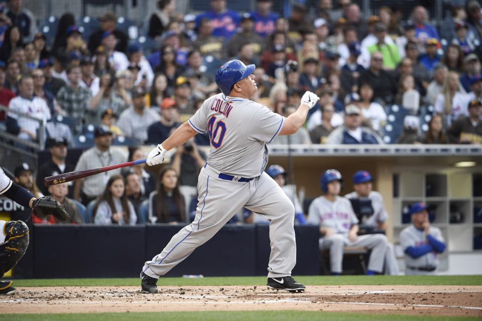 Mets pitcher Bartolo Colon hits a home run in San Diego.