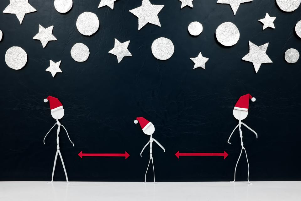Stick figures in santa hats socially distancing