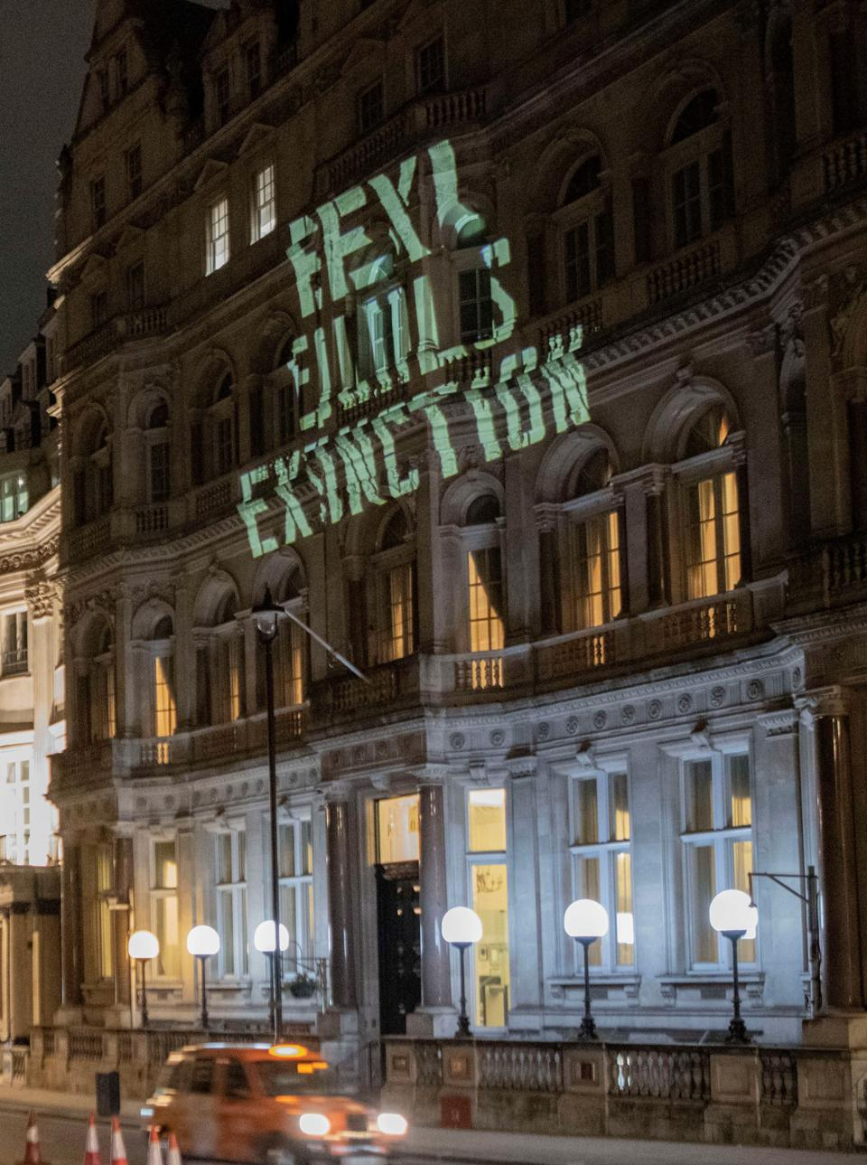 19 Oct: EEXI = Extinction. A protest sign projected against the Japanese embassy in London in protest at Japan's watered down proposal against climate change.