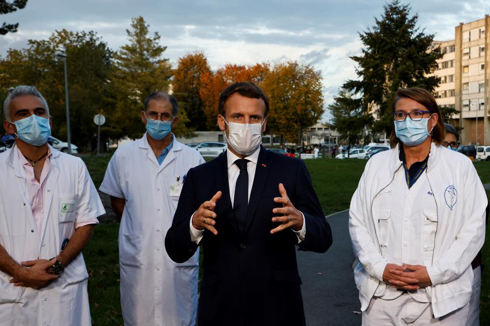 French President Emmanuel Macron speaks to the press after meeting with medical staff in Pontoise, in the Val d'Oise, on October 23, 2020,