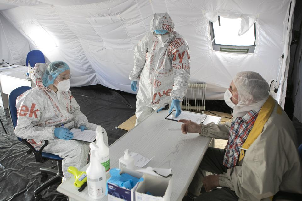Medical workers treat patients in a field emergency care unit in Lublin, Poland.